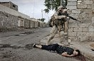 A U.S Marine from the 1st U.S Marines Expeditionary Force, 1st Battalion, 3rd Marines Regiment, Bravo Company passes by the dead body of a suspected member of the Iraqi guerrillas. U.S. troops powered their way into the center of the insurgent stronghold of Fallujah, overwhelming small bands of guerrillas with massive force, searching homes along the city's deserted, narrow passageways and using loudspeakers to try to lure militants onto the streets.